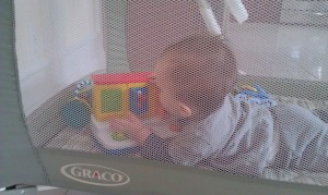 baby in playpen